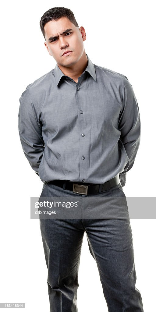 Frowning Young Man Standing : Stock Photo