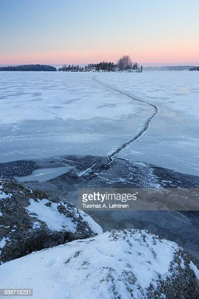 Frozen and snowy lake at morning in Finland
