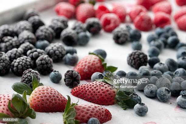 frozen berries - frozen fruit stock pictures, royalty-free photos & images