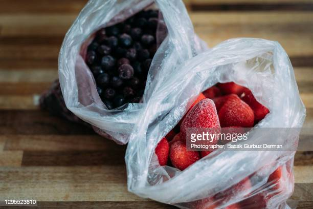 frozen blue berries and strawberries - freshness stock pictures, royalty-free photos & images