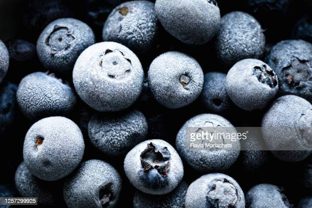 frozen blueberries - frozen food stock pictures, royalty-free photos & images