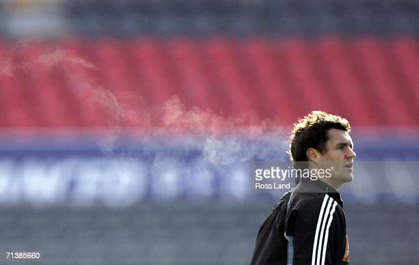 Frozen breath trails from the mouth of Dan Carter as he exhales during the All Blacks Captains' run at Jade Stadium on July 07 2006 in Christchurch...