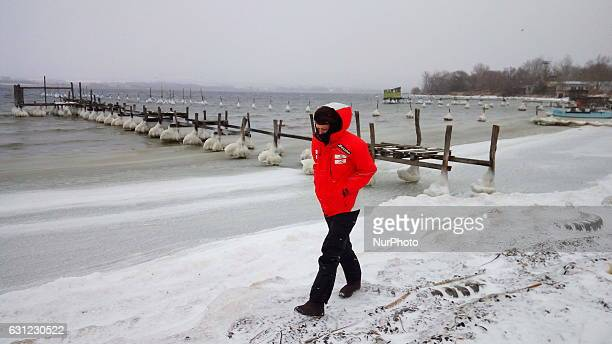 Frozen bridges small fishing boats and stones on the coast are seen near the Black sea town of Varna some 450 km east of the Bulgarian capital Sofia...