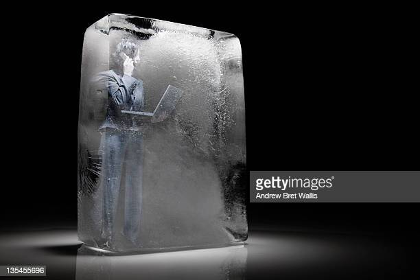 Frozen businesswoman with laptop & mobile