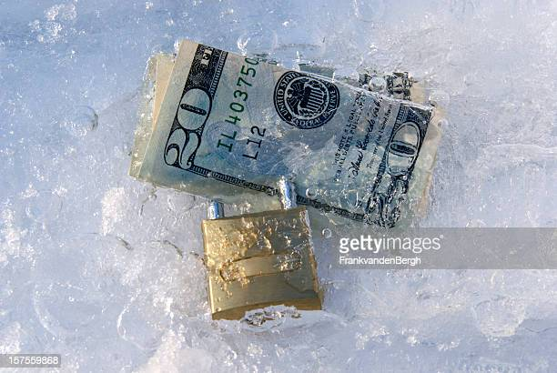 Frozen dollars with padlock