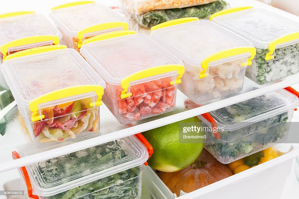 Frozen food in the refrigerator. Vegetables on the freezer shelves. : Stock Photo