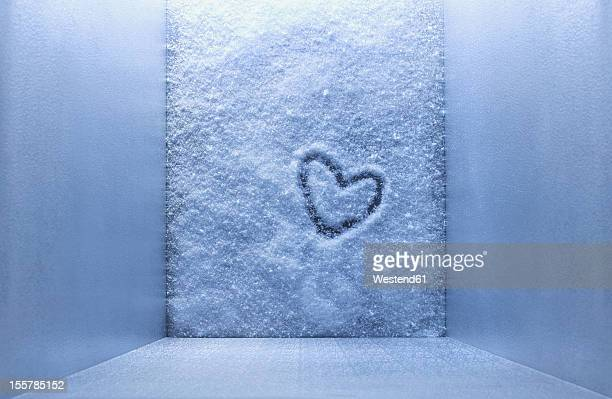 frozen heart shape in freezer - freezer stock photos and pictures