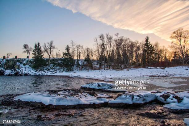 frozen lake against sky during winter - minnesota stock pictures, royalty-free photos & images