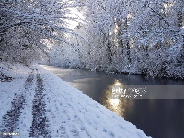 frozen lake against sky during winter - birmingham uk stock photos and pictures