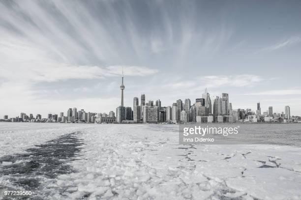 Frozen lake and cityscape, Toronto, Ontario, Canada