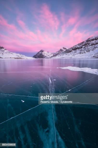 frozen lake bianco, bernina pass, switzerland - european alps stock pictures, royalty-free photos & images