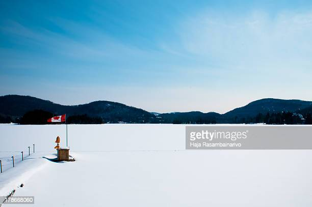 frozen lake in canada - mont tremblant stock pictures, royalty-free photos & images