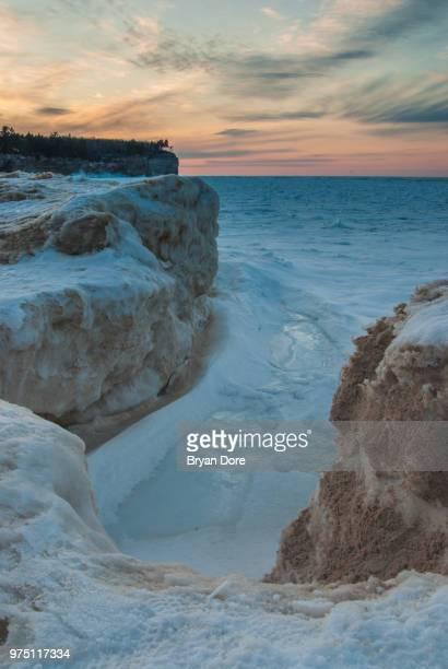 Frozen Lake Superior at sunset, Michigan, USA