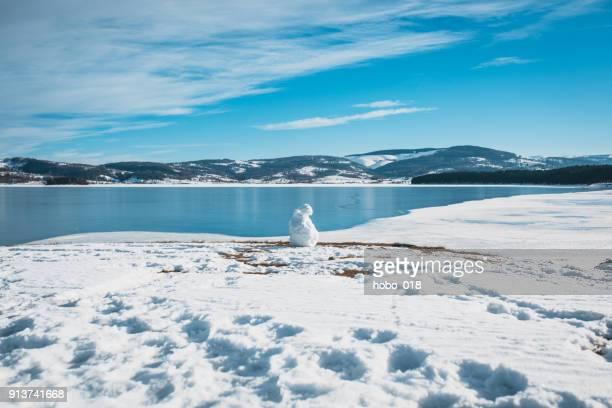 Frozen lake under a blue sky in the winter