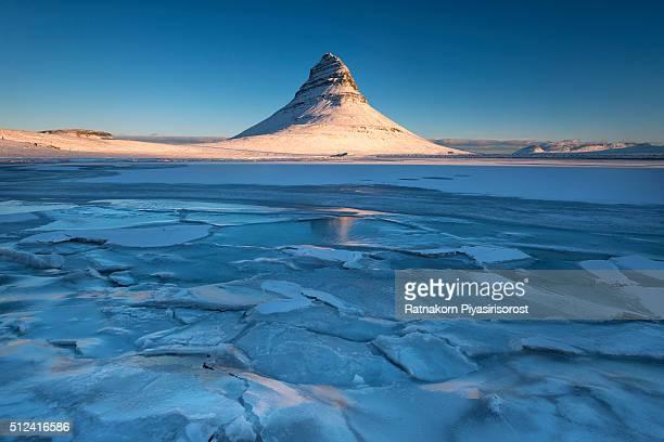 Frozen Lake with Kirkjufell Mountain in Winter Scene