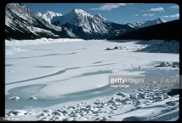 Frozen Lake With Snow Below Mountains