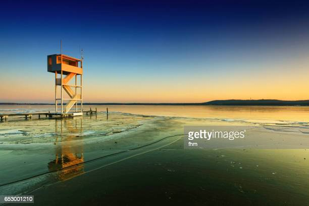 frozen lake with tower for the lifeguards in summer (berlin - müggelsee, germany) - köpenick stock pictures, royalty-free photos & images