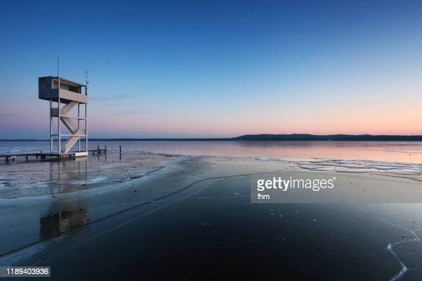 frozen lake with tower for the lifeguards (berlin - müggelsee, germany) - köpenick stock pictures, royalty-free photos & images