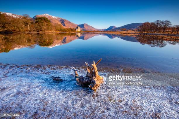 frozen loch awe with kilchurn castle in the distance, scotland. uk. - argyll and bute stock photos and pictures