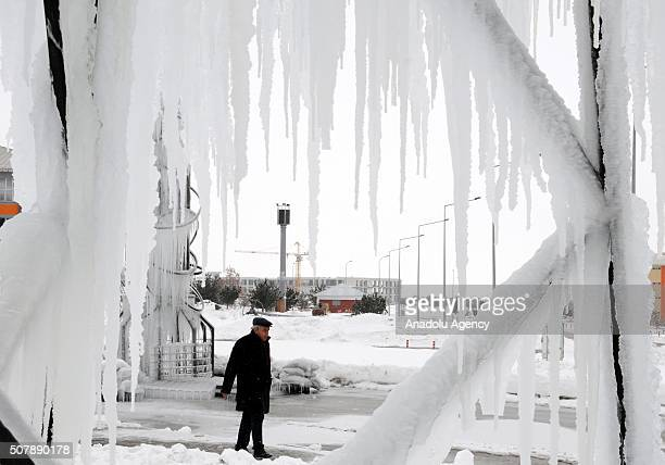 Frozen metal sculptures are seen covered with icicles due to cold weather at the campus of Ataturk University in Erzurum Turkey on January 31 2016...