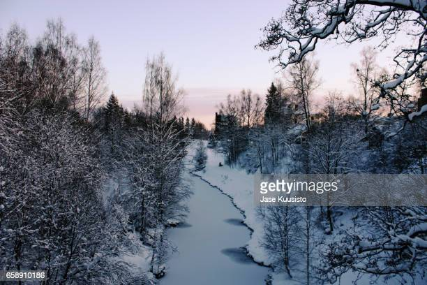frozen river during sunset in finland - jyväskylä stock photos and pictures