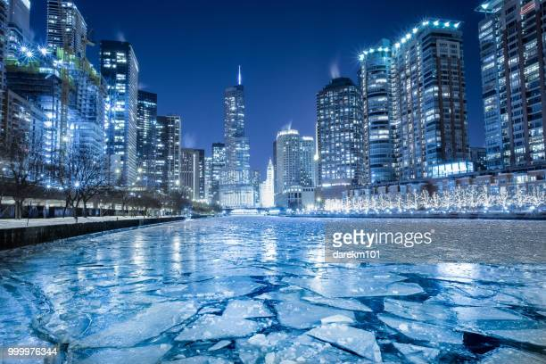 frozen river in winter, chicago, america, usa - chicago river stock pictures, royalty-free photos & images