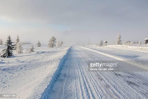 Frozen road in snow landscape,Norway.