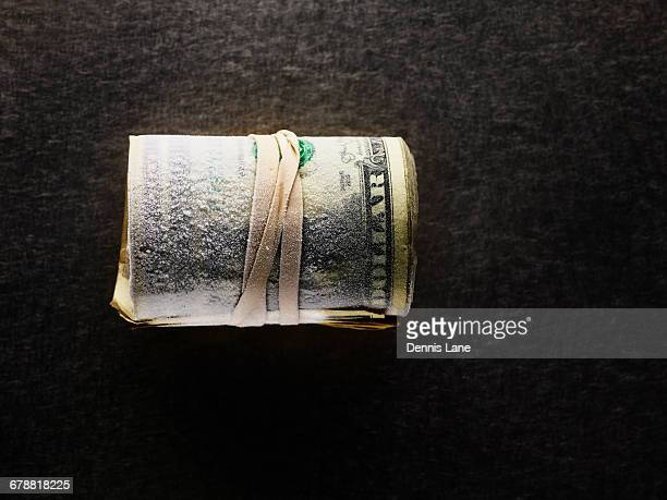 Frozen roll of dollar bills