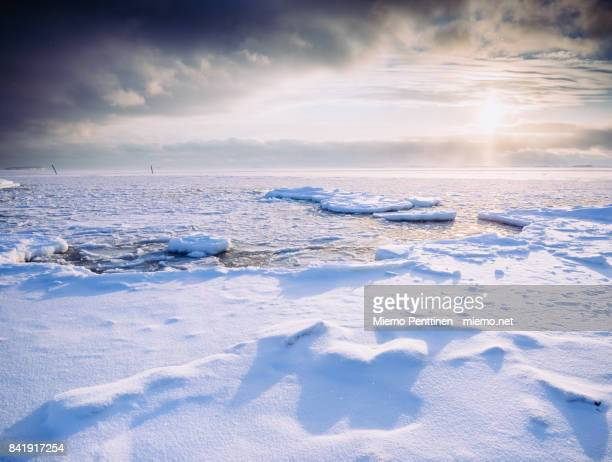 Frozen sea by the Helsinki shoreline in the Suomenlinna island