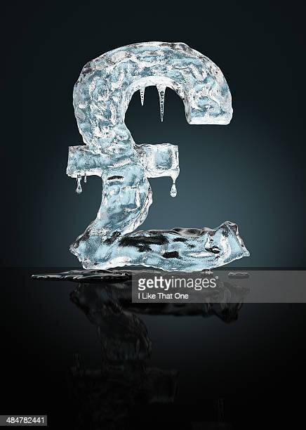 frozen sterling pound - frozen stock pictures, royalty-free photos & images