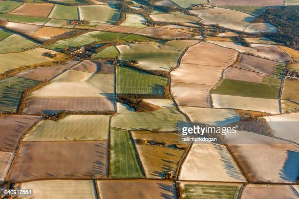 frozen vegetable plant fields from aerial view at winter snow in edinburgh england