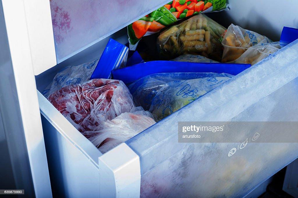 Frozen vegetables in freezer : Stock Photo