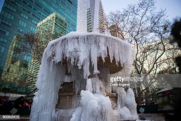 Frozen water stands on the fountain in Bryant Park January 3 2018 in New York City New York City was placed under a winter storm watch Wednesday as a...