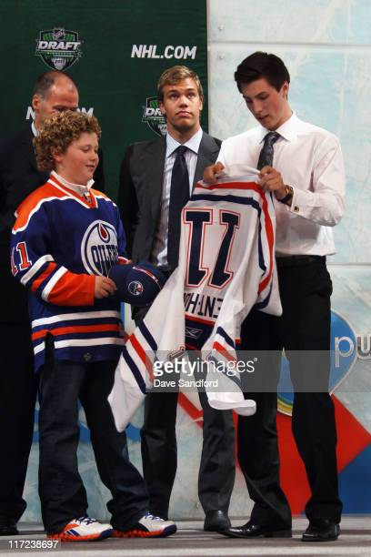 Frst overall pick Ryan NugentHopkins by the Edmonton Oilers puts on an Edmonton Oilers jersey during day one of the 2011 NHL Entry Draft at Xcel...