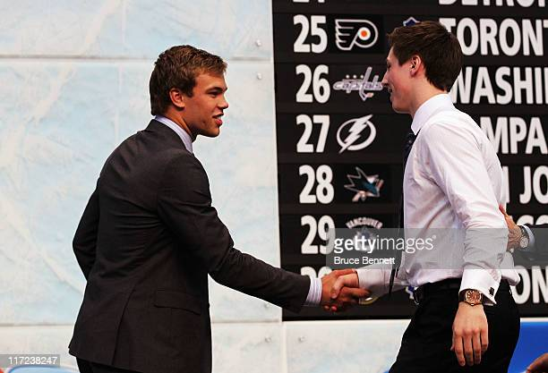 Frst overall pick Ryan NugentHopkins by the Edmonton Oilers shakes hands with 2010 first overall pick Taylor Hall of the Edmonton Oilers during day...