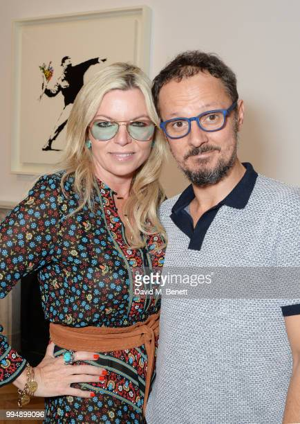 Fru Tholstrup and Jonathan Yeo attend the Bansky 'Greatest Hits 20022008' exhibition VIP preview at Lazinc on July 9 2018 in London England