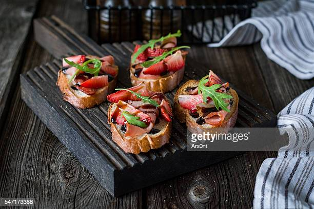 Fruit and meat bruschettas, set for wine