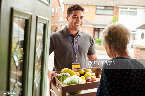 fruit and veg delivery - volunteer stock pictures, royalty-free photos & images