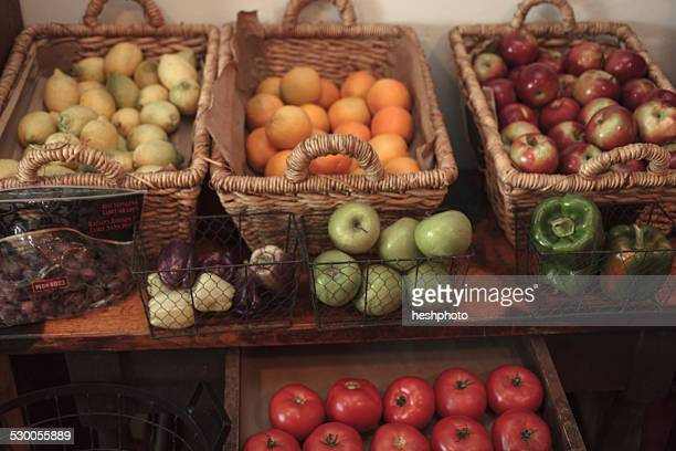 fruit and vegetable baskets in country store - heshphoto imagens e fotografias de stock
