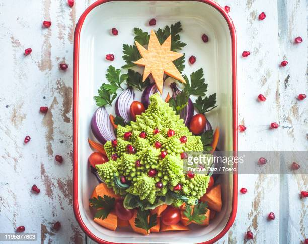 fruit and vegetable christmas tree - vegetarianism stock pictures, royalty-free photos & images