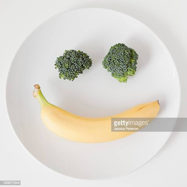 fruit and vegetable smiling face on plate, studio shot - smiley face stock pictures, royalty-free photos & images