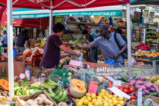 Fruit and vegetable stall trades at Brixton market on June 01, 2020 in London, England. Despite a government announcement that open air markets would...