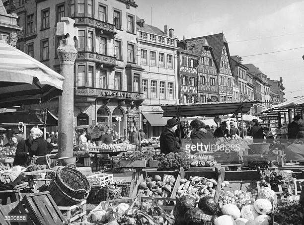 Fruit and vegetable stalls in the street market at Trier Germany