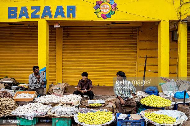 Fruit and vegetable vendors wait for customers at a local street market in Mapusa Goa India on Wednesday March 9 2016 While India is forecast to...
