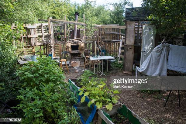 Fruit and vegetables and a home-built pizza oven and shower are seen at the Stop HS2 Wendover Active Resistance Camp on 17th July 2020 in Wendover,...
