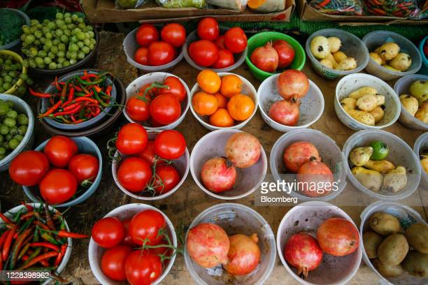 Fruit and vegetables sit on display at an outdoor market stall at Chrisp Street Market in Poplar, London, U.K., on Thursday, Aug. 27, 2020. Healthy...