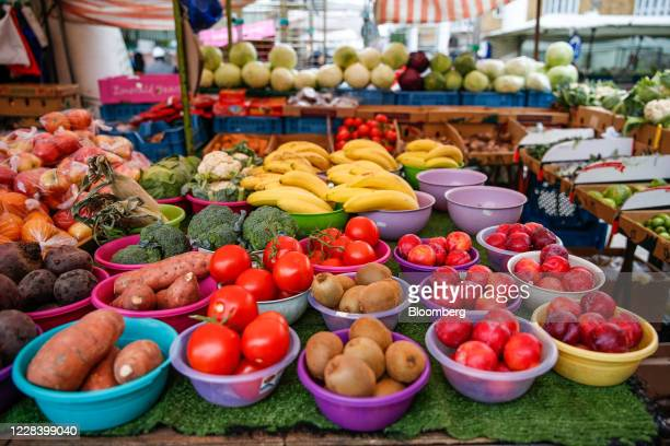 Fruit and vegetables sit on display at an outdoor market stall at Chrisp Street Market in Poplar London UK on Thursday Aug 27 2020 Healthy and...