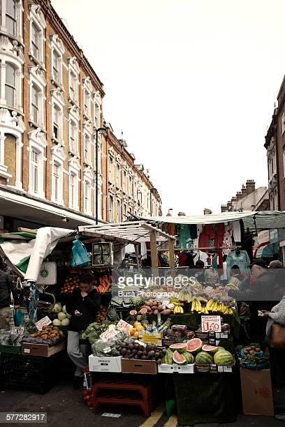 fruit and vegetables vendor at brixton market - brixton stock pictures, royalty-free photos & images