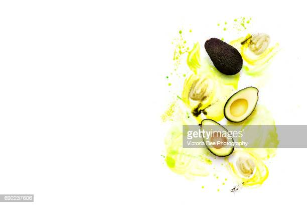 Fruit: Avocado Isolated on White Background. Creative food shot with watercolor.
