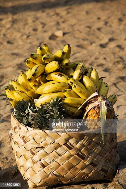 Fruit basket on beach.